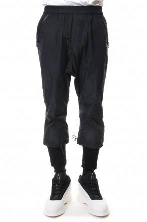 NILøS 19SS SPINDLE LAYERED HEM TRACK PANTS